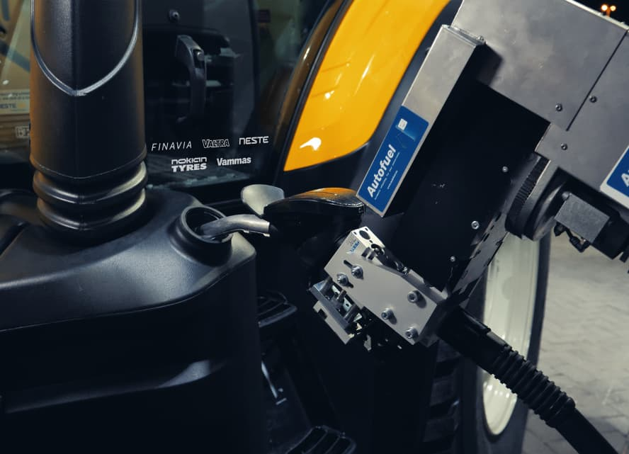 Tractor being refueled with Neste MY renewable diesel fuel by Autofuel robot system