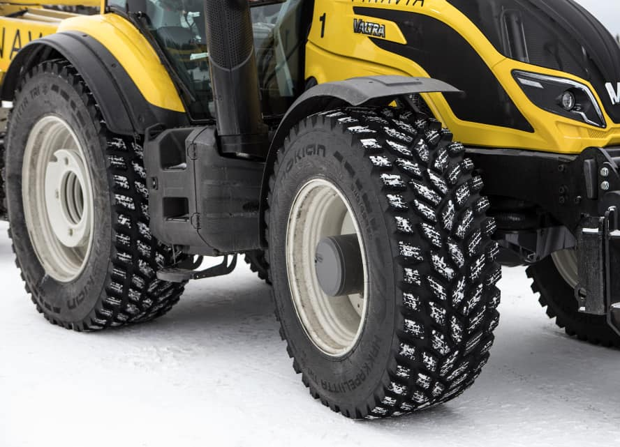 Valtra tractor plowing snow with Nokian TRI 2 winter tires by Nokian Tyres